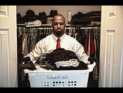 179/365 - LAUNDRY DAY (Arieseffects) Tags: portrait me hat self closet gun august clothes laundry 365 lakers 2009 hangers 9mm starch redtie hitman tdm dirtyclothes creativeli