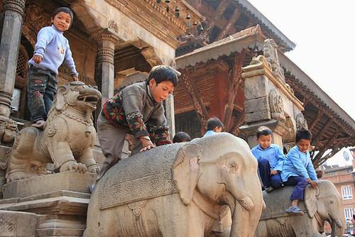 Children climbing elephant statues 5
