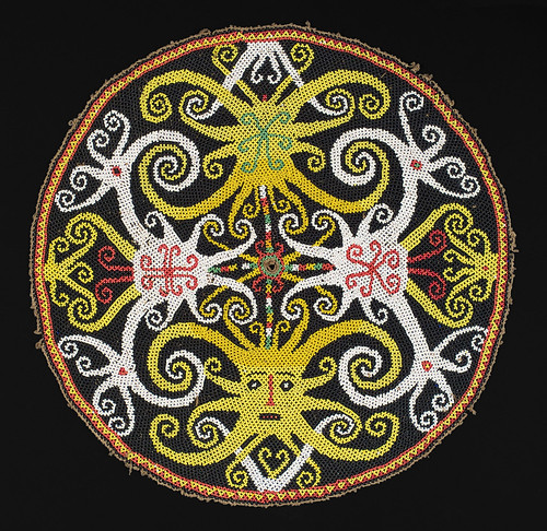 //Bead Panel//, Bahau people. Borneo 20th century, diameter 38 cm. From the Teo Family collection, Kuching. Photograph by D Dunlop.