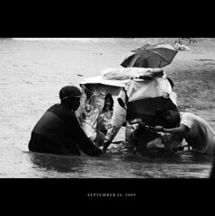 "Typhoon Ketsana ""Ondoy""  (Cherry Desuasido) Tags: boy blackandwhite bw man water photo flood action philippines tragedy manila filipino pedicab pinoy typhoon calamity baha bagyo ketsana ondoy typhoonondoy manilaflood ondoyflood"