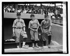 [Three baseball players (boys) wearing Clevela...