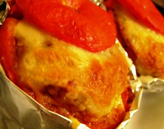 Baked beef tomatoes with bolognaise rizoni