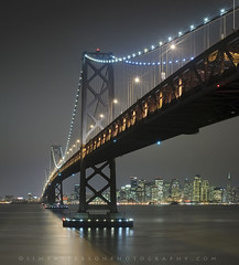 City at Night - San Francisco Bay Bridge, California (Jim Patterson Photography) Tags: ocean sanfrancisco california city longexposure blue sea sky orange usa color reflection water night landscape gold lights bay colorful cityscape pacific tripod scenic wideangle shore lee baybridge vista gitzo yerbabuenaisland nikkor3570mm graduatedneutraldensityfilter nikond300 markinsm20ballhead jimpattersonphotography jimpattersonphotographycom seatosummitworkshops seatosummitworkshopscom