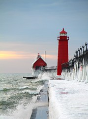 Frozen Lighthouse Season '09 (PhotoDocGVSU) Tags: winter sunset lighthouse cold ice frozen lakemichigan greatlakes grandhavenmi