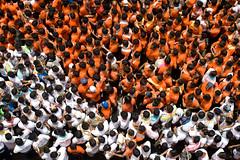 Sea of humanity (anupama kinagi) Tags: life street people orange india men colors festival team asia pattern chaos pyramid unity crowd human maharashtra mumbai teamwork govinda lordkrishna dahihandi janmashthami anupamakinagi gokulashthami