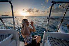 Mary Washing Off at Sunset (Jason Pratt) Tags: ocean light sunset vacation sky water clouds sailboat island boat sailing mary deck caribbean grenadines bathing stern washing canouan charlestownbay