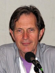 Closeup of Geoff Ryman speaking into the microphone