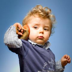Ready to throw shoe on Sarkozy face (Cdric Chapuis) Tags: portrait face square shoe eos 50mm child ivan gimp blond enfant visage lightroom 30d chaussure canonef50mmf18ii sb28 sb20 2light
