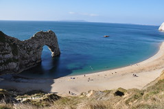 Durdle Door, Dorset (JRT ) Tags: blue sea sky people sun holiday green beach water grass nikon rocks warm arch sunny dorset portlandbill durdledoor d90 thegalaxy johnwarwood flickrjrt