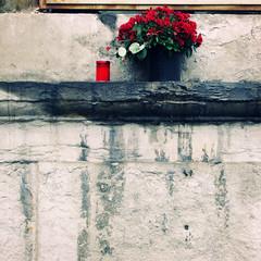 pietas (...are YOU ready?) Tags: flowers red water rain stone candle milano sanlorenzo ticinese pietas