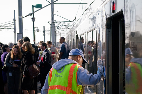 Metro employees polish the Gold Line train cars before they depart with dignitaries to East L.A. Civic Center.