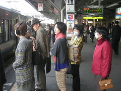Lined up, wearing masks in Japan.