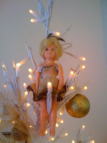 My 48 year old Fairy. I was given this on the day my brother Kevin was born. 48 years ago last 30th November. She sits at the top of my tree every year!.