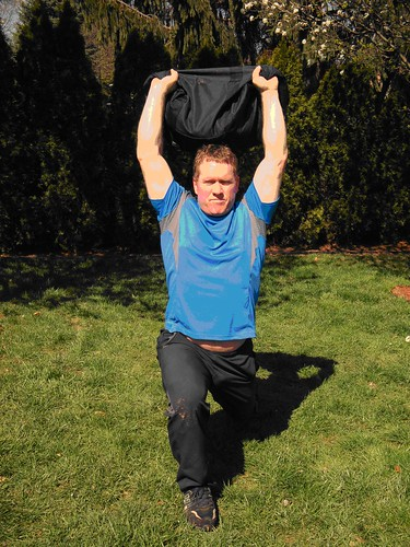 overhead lunge with sandbag