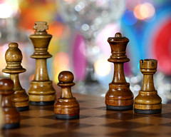 Chess with champagne ! (Mukumbura) Tags: wood blue red orange brown sunlight game castle glass silver computer shiny king dof bright crystal bokeh squares board champagne flash contest chess competition battle queen depthoffield diagonal sparkle intelligence tiles rook bishop sparkling strategy pawn chessboard kasparov deepblue grandmaster canonef100mmf28macrousm