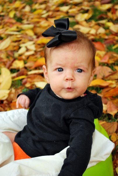 E in the Leaves on Her First Halloween