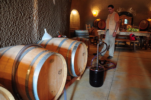 into oak barrels in the wine cave. With a short stop in a carboy for measurement purposes.
