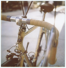 My little birdie (Suguru Nishioka) Tags: color film bicycle square polaroid sx70 bokeh steel touring bianchi lugged nocropthisyear 1981vintage iloveluggedsteelframebikes probablysltrianglebutnotsureoftherest anditsreallyhardtofindmysize yesidocoloronceinawhile thebikeissameageasme illprobablyswapsomecompobutwillrideprettymuchasis nothingfancybutanicecityride columbustretubi nuovatouring