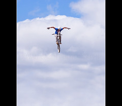 flying spirit...   ;) (Erwan bazin photography (F2.8) very busy!) Tags: sky angel clouds canon fly flying reflex jump bmx freestyle ange champion bretagne superman breizh ciel vol nuages 18200 vlo saut attraction esprit spectacle finistre bazin envol gravit spitit 50d bicross lvation apesanteur canoneos50d phisique landrvarzec bazinerwan sautdelange flyingspirit 18200is erwanbazinphotographie finistairshow
