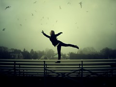 Beating Wings (Rowena R) Tags: colour movement r themed rowena arabesque dancerpose dancingonbench birdsinskyportrait