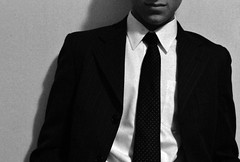 Black Tie Event (Nikoliparty) Tags: shadow party black smile tie event whitebackground fancy knowing unknown mysterious grin simple nordstroms plain blacktie dressy blackandwhitephotography pokadots dkny whiteshirt halfface blacksuit dressclothes