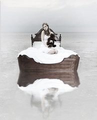 my bed is a lonely boat (Leah Johnston) Tags: ocean bear portrait woman white lake selfportrait water girl female self bed leah fineart dream surreal sheets fantasy teddybear serene lonely blankets float pure johnston eternalsunshineofthespotlessmind whitedress selfportraitartist leahjohnson leahjohnston leahjohnstonphotography leahjohnstonphotos