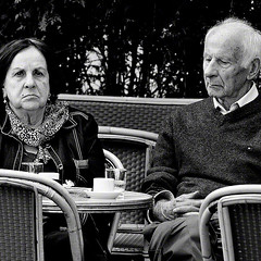 Together,yet alone ...... (fifichat1 - BOYCOTT) Tags: street portrait people urban blackandwhite bw woman man paris france couple candid  streetphotography nb grayscale bastille greyscale copyright squarepicture allrightsreserved cafescene classicbw formatcarr squarephotography copyrightallrightsreserved tousdroitsrservs nikond300 tousdroitsrservs digimarc2011 lightroomps fifichat1