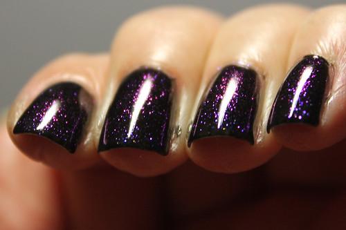 CND Sapphire Sparkles over OPI Black Onyx