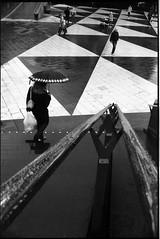 (flevia) Tags: bw analog umbrella blackwhite sweden stockholm baltic bn sergelstorg nophotoshop stoccolma biancoenero nikonfa foma svezia hotorget analogico fomapan nikkor35mmf2 scannednegatives fomapan400 epsonv700 thebaltics autaut epsonperfectionv700photo flevia imanalog