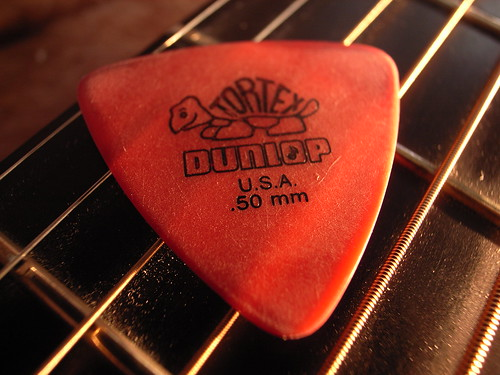 Red colored guitar pick