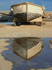 The two faces of Janus (Alda Cravo Al-Saude) Tags: reflection boat woodenboat oldboat woodboat