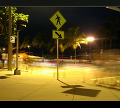 Human Xing (ReadyAimClick) Tags: ocean longexposure trees people usa motion blur cars beach sign night walking concrete lights streetlight shadows nightshot florida sidewalk palmtrees fortlauderdale neonlights ghosts lighttrails crosswalk rac readyaimclick sebastainst