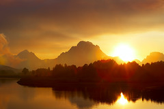 Arnica at Oxbow (Leviathor) Tags: park travel sunset usa mountains reflection nature water backlight river fire smoke lensflare snakeriver yellowstone ripples wyoming mountmoran 2009 grandtetonnationalpark oxbowbend roadtrip2009 arnicafire