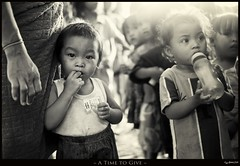 A Time to Give (Jaydee Pan (Stopped for a while)) Tags: street charity people food baby canon children real kid feeding candid 14 philippines sigma give filipino feed bata tao pinoy pinas buhay 30mm mabuhay 400d