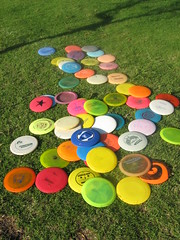 sunbathing frisbies (Willowpoppy) Tags: park abstract color colour grass sport fun outdoors october play circles colores colori sunbathing farben frisbie coleur