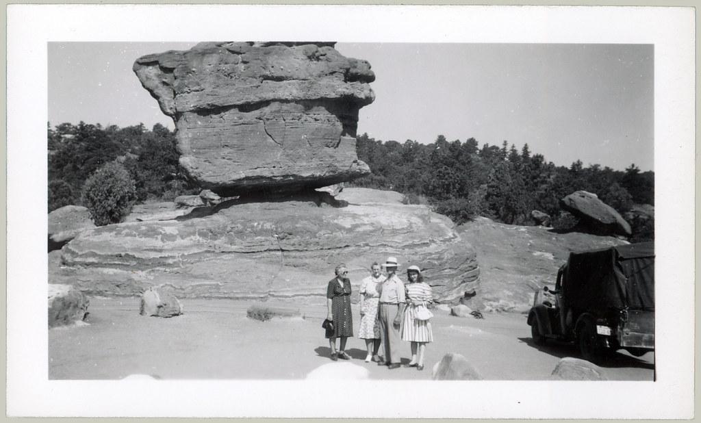 balancing rock and 4 people