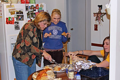 IMG_0387 (agentsmj) Tags: thanksgiving family kitchen dinner turkey hoodie skin eating daughter aunt niece cutting stealing carvingturkey electricknife amyantal carololiver hollyoliver
