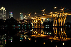 beneath the dancing stars (yyelsel_ann) Tags: city longexposure bridge reflection water night canon buildings singapore nightshot benjaminshearesbridge singaporebridge 1855kitlens streetlamplights gettyimagessingaporeq1