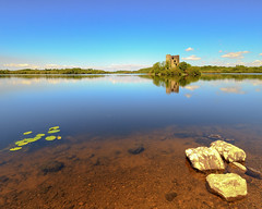 Cloughoughter Castle. (shakeyhands2212) Tags: blue trees ireland sky lake reflection green castle june clouds rocks 7d 1020 lillypads ulster sigma1020 countycavan loughoughter canoneos7d absolutelystunningscapes niallcolgan cloughoughtercastle