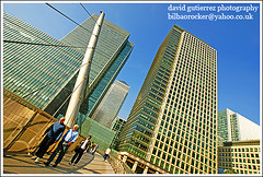 London Canary Wharf  Architecture ~ The Glass Jungle...~ (david gutierrez [ www.davidgutierrez.co.uk ]) Tags: city uk bridge blue england sky people urban sun building london tower glass architecture skyscraper work buildings spectacular geotagged photography photo office arquitectura cityscape image sony centre cities cityscapes bridges bluesky center structure architectural 350 jungle londres architektur docklands sensational metropolis alpha 1001nights canarywharf londra impressive dt urbanspaces cityoflondon eastlondon municipality edifice tallbuildings cites financialcentre ogilvymather westindiadocks f4556 thamesriverside 1118mm mywinners michaelvonclemm theunforgettablepictures platinumheartaward glassjungle businessandshoppingdevelopment sonyalphadt1118mmf4556 gwaretravelstead sony350dslra350