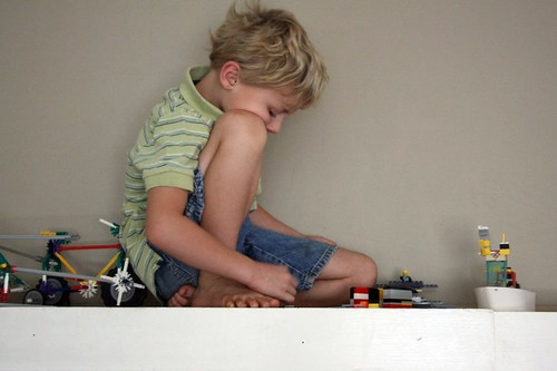 a boy and his legos on the mantle