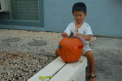 Owen decorating his pumpkin