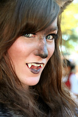She Wolf Smiles (wyojones) Tags: woman girl beautiful beauty smile face look animal festival tongue mouth eyes skins wolf texas expression lips trf bite faire renfaire brunette renaissancefestival fangs facepaint renaissance renaissancefaire renfest element rennie shewolf texasrenfest texasrenaissancefestival plantersville animalskins wolfwoman toddmission toddmissiontexas wyojones elementofair