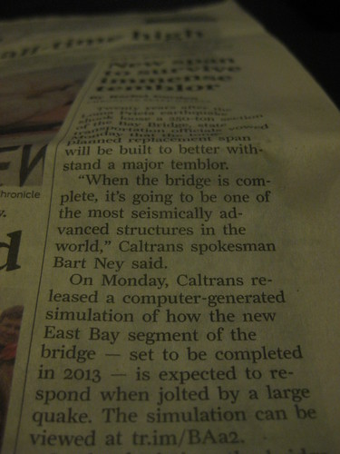 photo of a newspaper column with article text including a tr.im shortlink