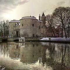 The Cross gate Bruges (genevieve van doren) Tags: trees light snow reflection water eau lumire brugge sint textures arbres bruges neige hdr kruispoort portesaintecroix