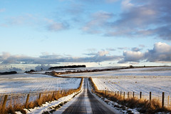 A Back Road (Michelle in Ireland) Tags: road winter light sky snow grass clouds fence scotland countryside vanishingpoint hills adventure fields backroad newyearseveday