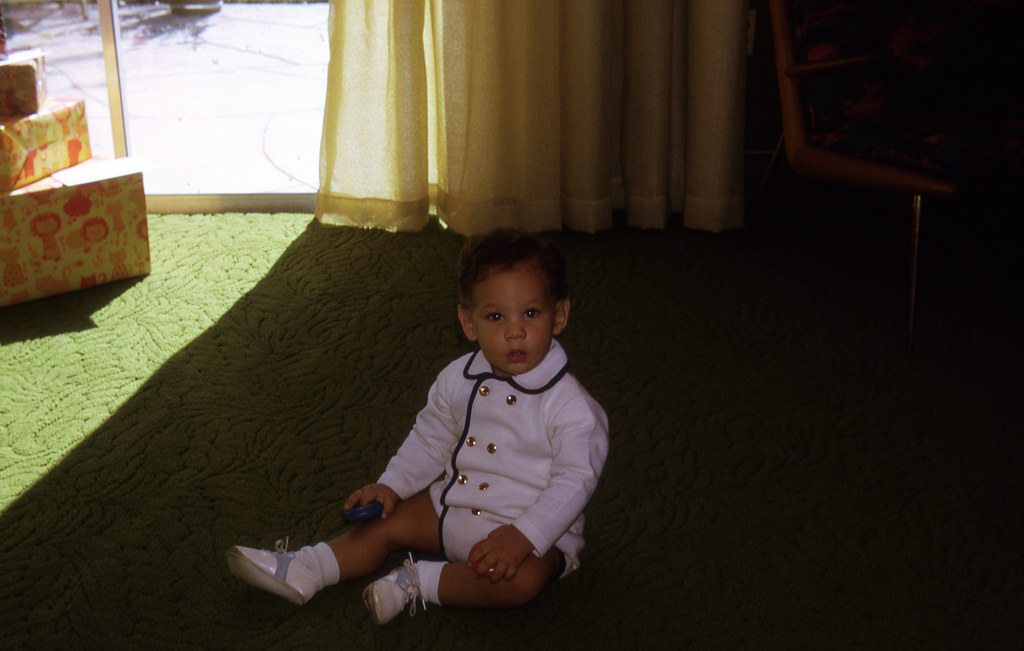 Bobby sitting on the new carpet