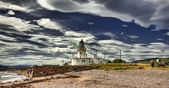 Chanonry Point Lighthouse (Uncle Berty) Tags: blue light sea sky house holiday black beach clouds point scotland dolphin uncle watching berty isle moray rosemarkie firth chanonry fortrose robfurminger