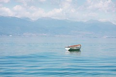 small boat (Uros Jonic) Tags: travel summer sky mountain detail art tourism nature water clouds contrast landscape photography boat photo day nopeople far enjoyment balkan bluecolor colorimage beautyinnature