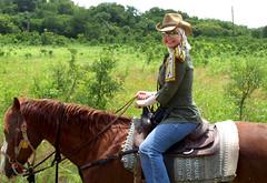 Nicole Queen on horseback